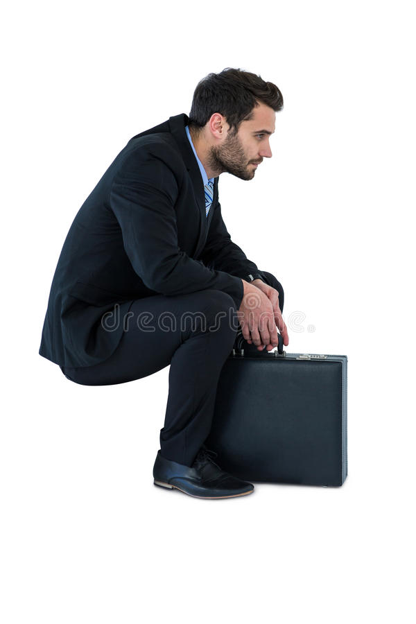 Businessman sitting on steps royalty free stock images