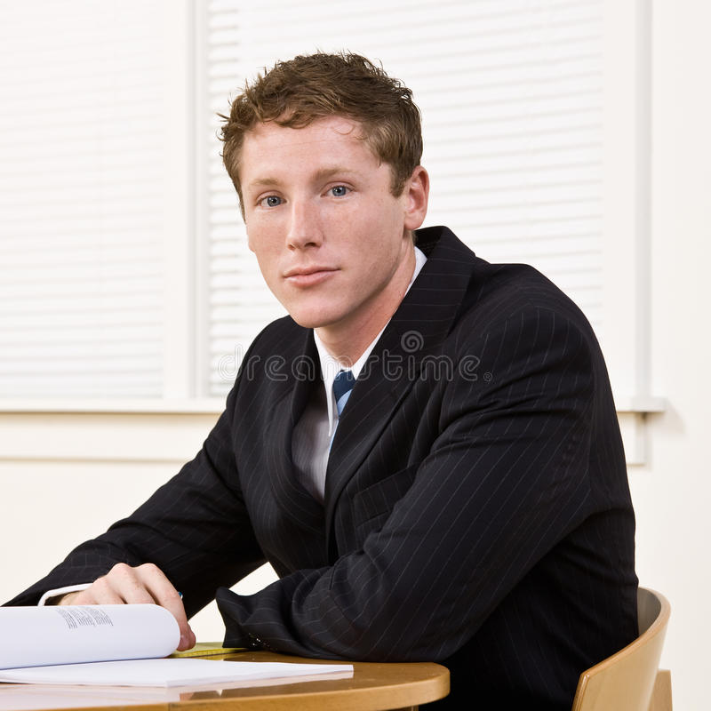 Businessman Sitting At Table Royalty Free Stock Photo