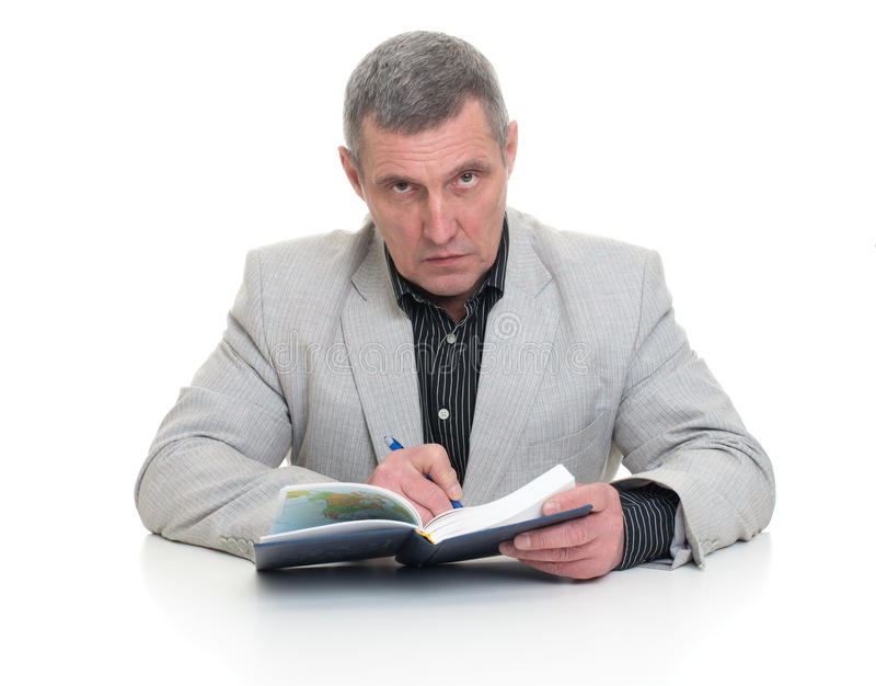 Businessman sitting at a table royalty free stock photos