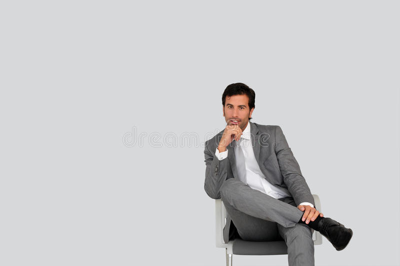 Businessman sitting in waiting room stock images