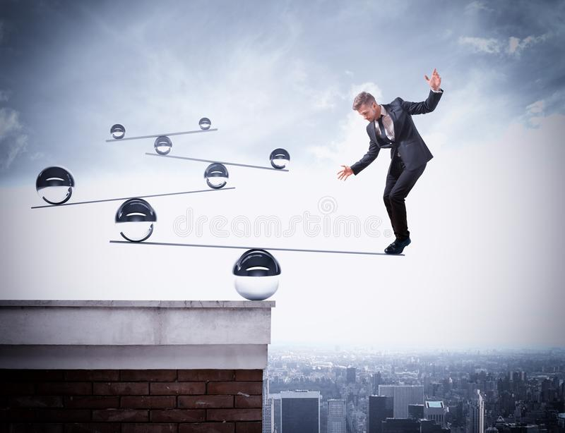 Businessman skill of balance. Businessman balancing on boards with iron balls royalty free stock photo