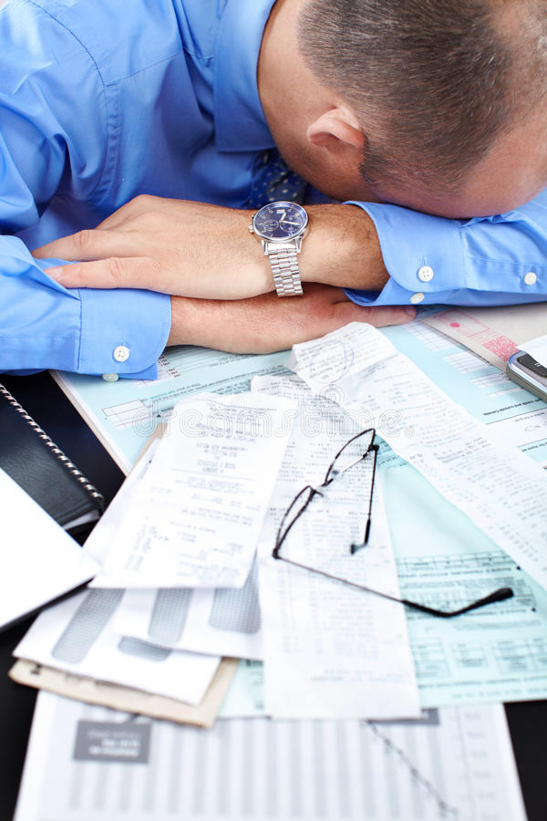 Businessman sleeping. In the office stock image