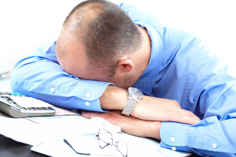 Businessman sleeping. In the office stock images