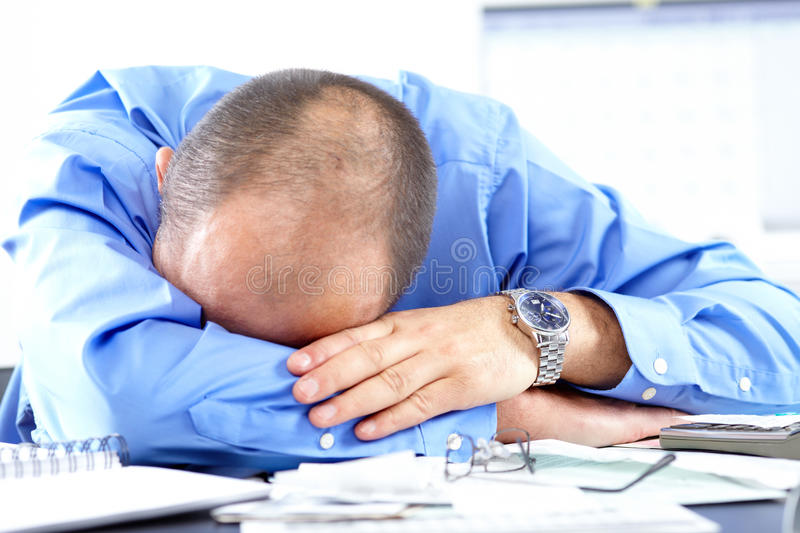 Businessman sleeping. In the office royalty free stock photos
