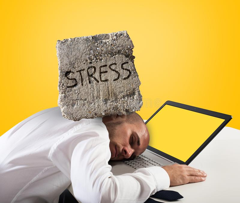 Businessman sleeping on a computer. Stress and overwork concept. Yellow background stock images