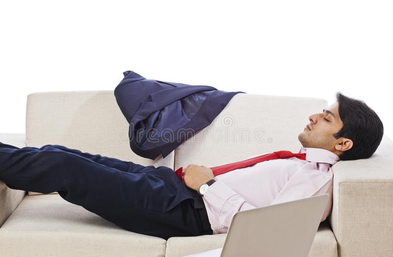 Businessman sleeping. On the couch stock photo