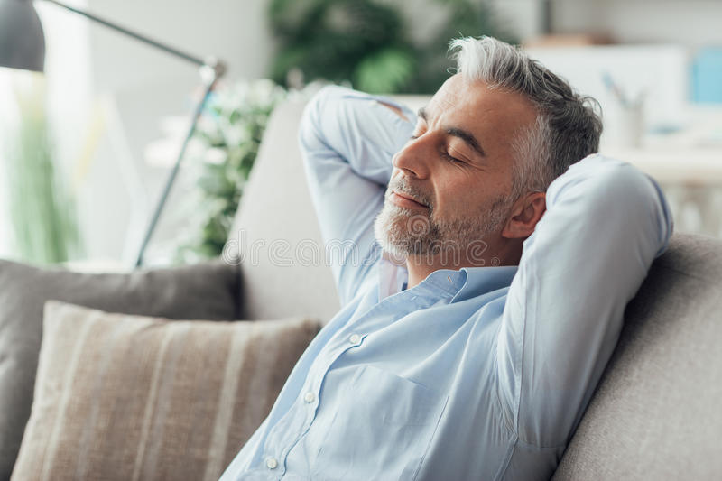 Businessman sleeping on the couch royalty free stock photo