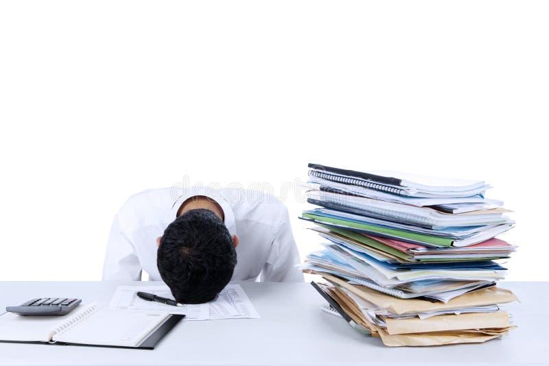 Businessman sleeping on the desk. Portrait of tired young businessman sleeping on the desk royalty free stock photos