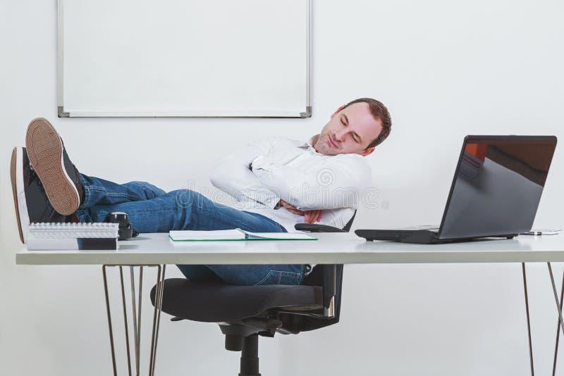 Businessman sleeping on the job at work. Businessman in his office sleeping on the job at work stock photos