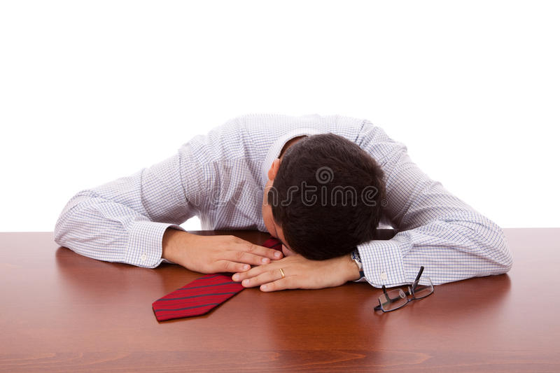 Businessman sleeping at the office. (isolated on white stock photography