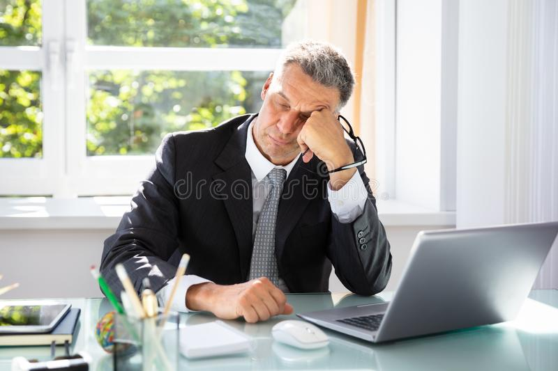 Businessman Sleeping In Office. Photo Of Tired Mature Businessman Sleeping In Office stock photos