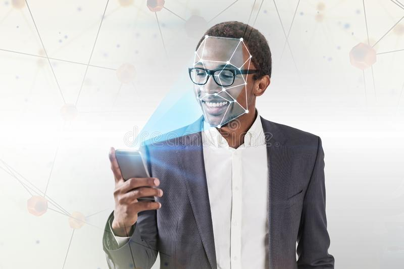 Businessman with smartphone face recognition royalty free stock photography