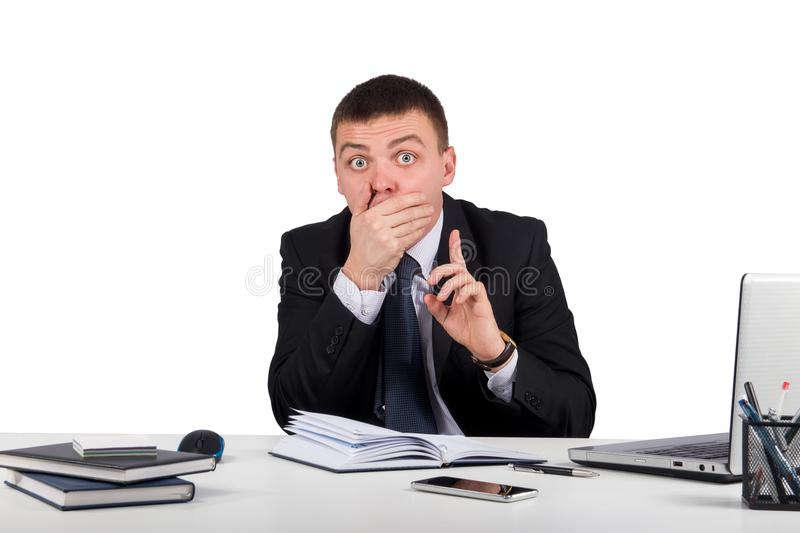 Businessman with smartphone holding his finger in front of his mouth and making silence gesture shh royalty free stock images