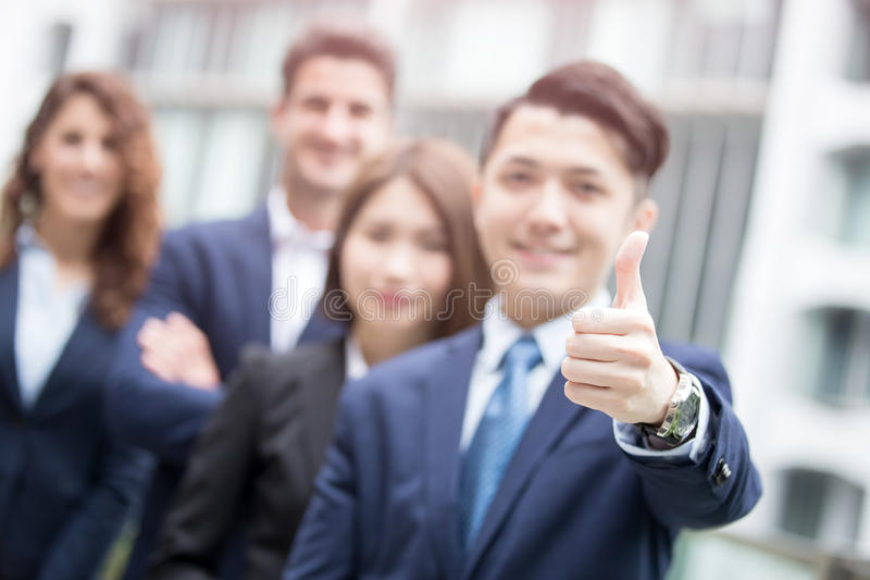 Businessman smiles show thumb up royalty free stock image