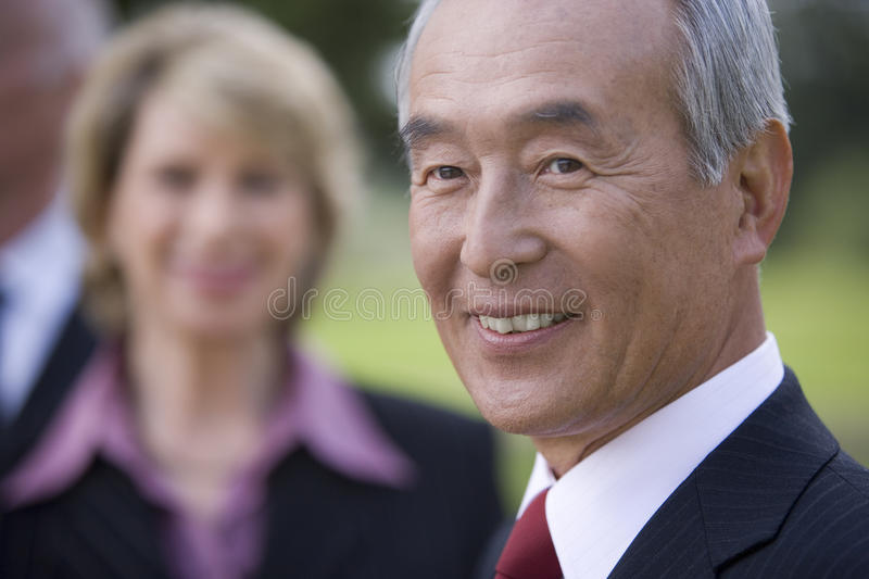 Businessman smiling by colleague, close-up stock image