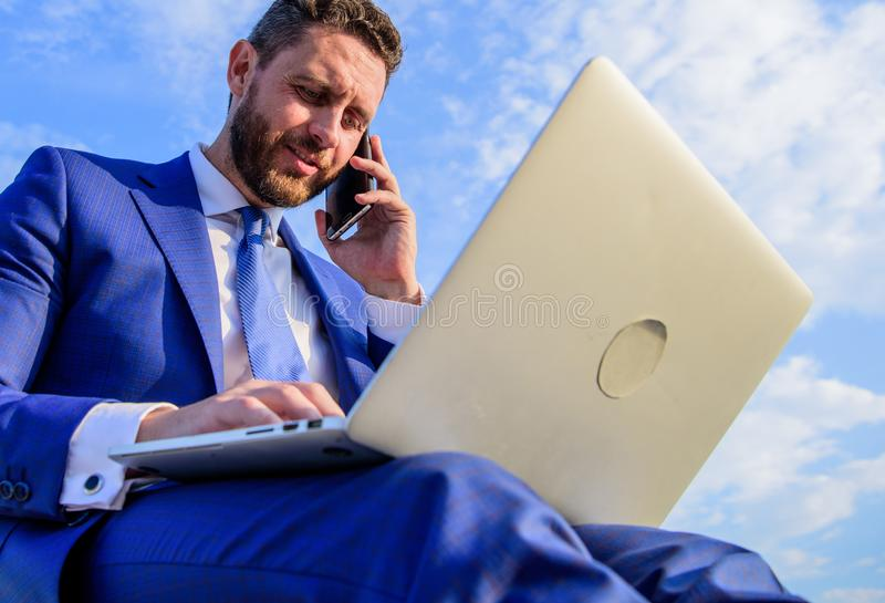 Businessman smiling pleasant face typing email laptop. Make sure your emails are as warm and personal as possible by royalty free stock image