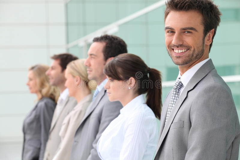 Businessman smiling with team