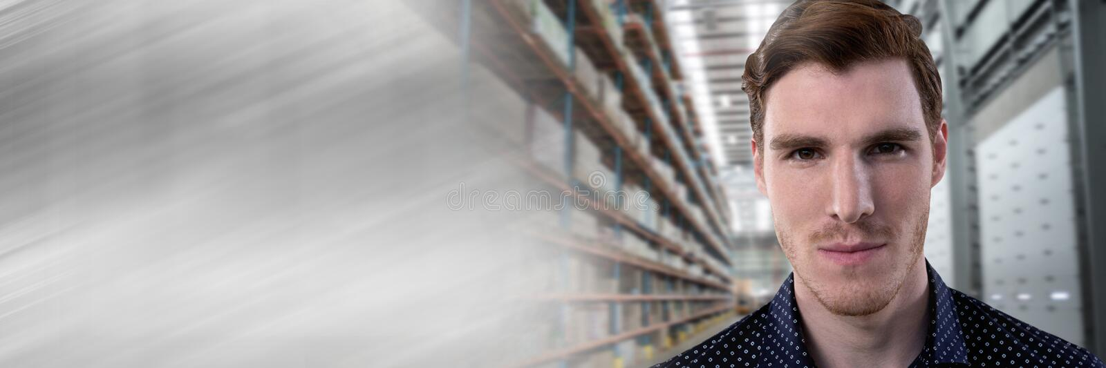 Businessman smiling in warehouse perspective with motion transition stock photo