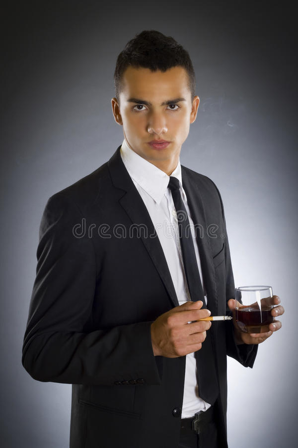 Download Businessman Smoking A Cigarette And Drinking Stock Image - Image: 11619627