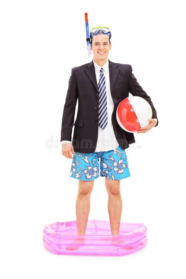 Businessman with snorkel standing in a small pool royalty free stock photo