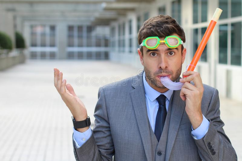 Businessman with snorkeling equipment isolated stock images