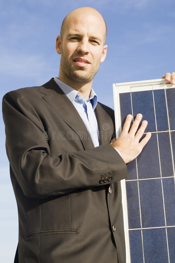 Businessman with solar panel royalty free stock image