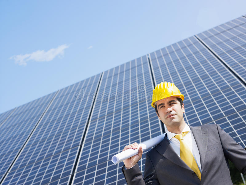 Businessman and solar panels stock image