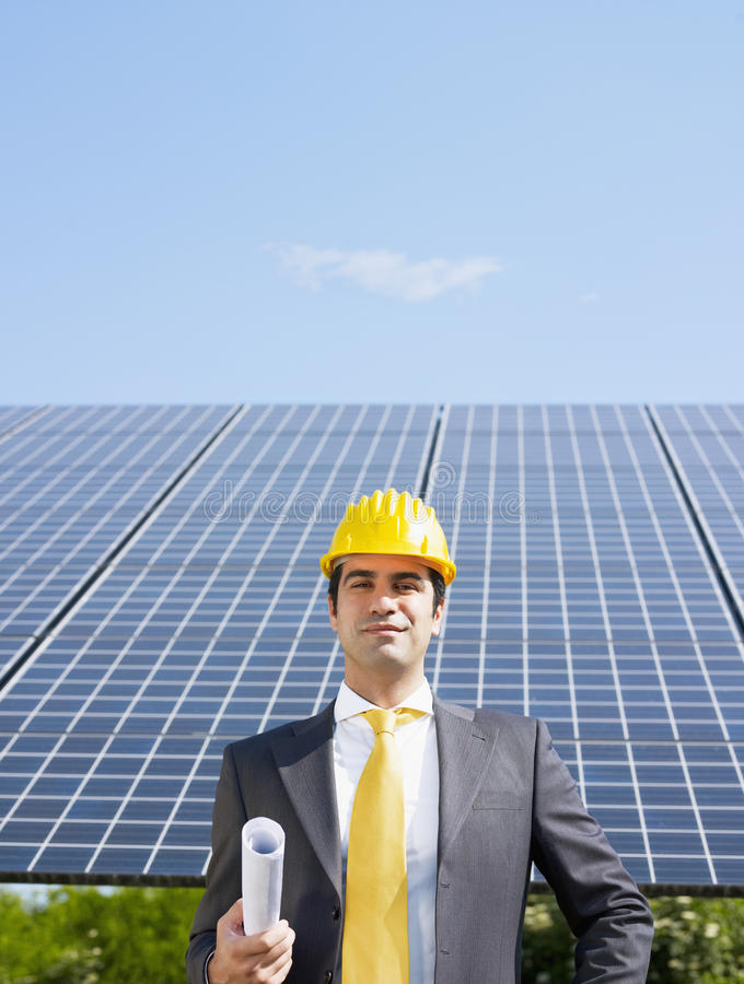 Download Businessman And Solar Panels Stock Photo - Image of looking, hardhat: 14615024