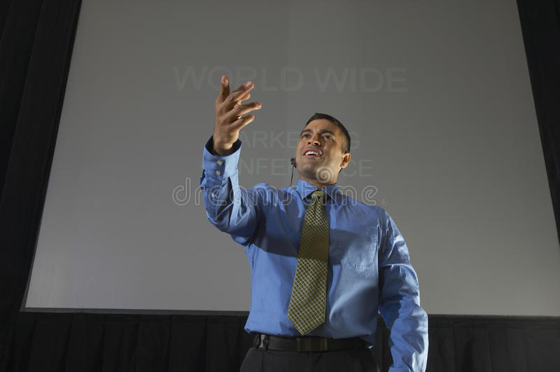 Businessman Speaking At Conference stock images