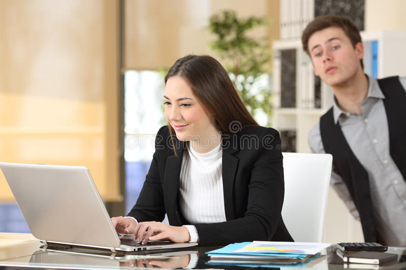 Businessman spying his colleague at job stock image