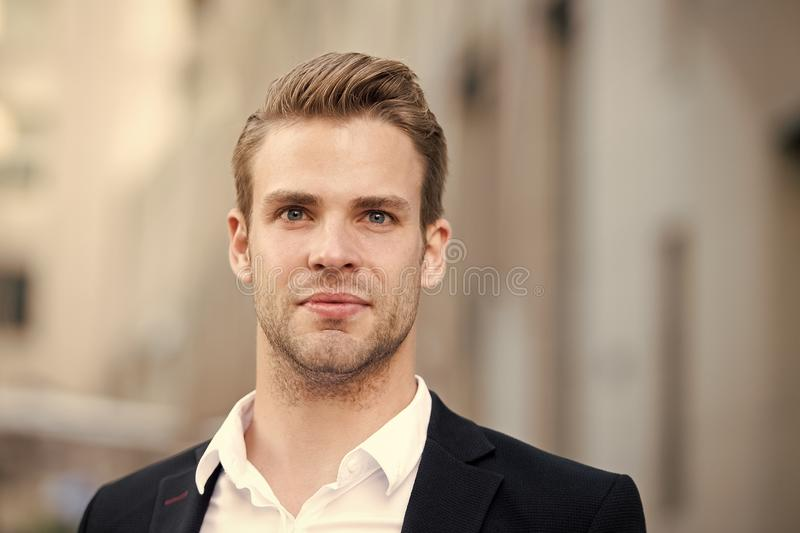 Businessman stand on urban background. Confident man in formal wear outdoor. This is my city. Male grooming for ceo at. Barbershop. Thinking about new stock image