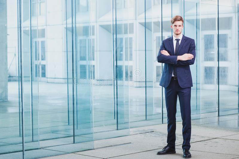 Full body portrait of businessman. Businessman standing on abstract business background, full body portrait royalty free stock photo