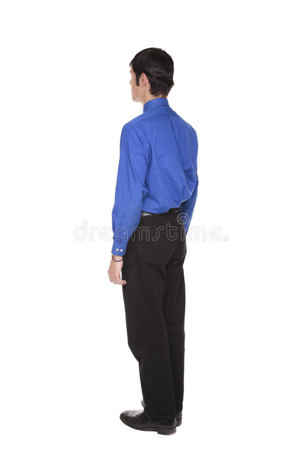 Businessman standing with arms at sides rear view royalty free stock image