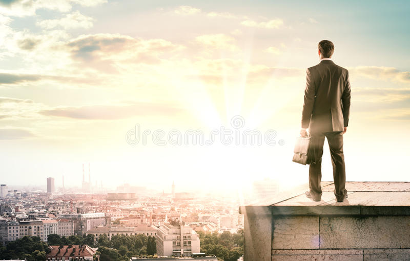 Businessman standing with back against city royalty free stock photo