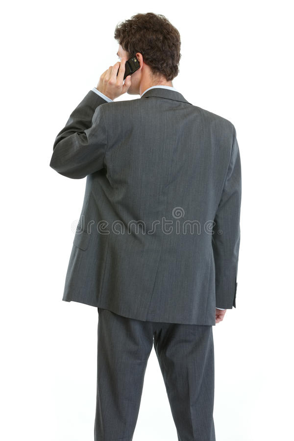 Download Businessman Standing Back And Speaking Mobile Stock Photo - Image: 24849952