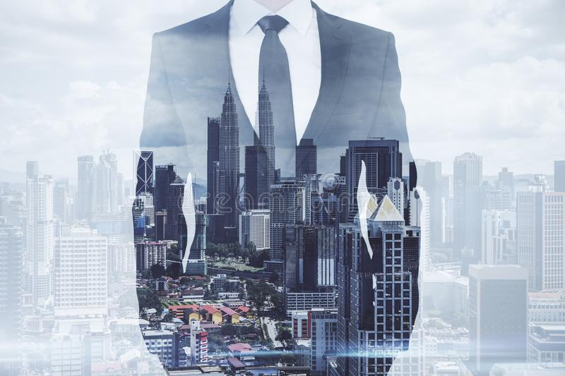 Success and future concept. Businessman standing on creative Kuala Lumpur city background. Success and future concept. Double exposure stock photo