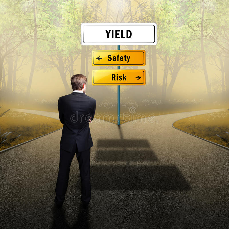 Businessman standing on a crossroad having the options Safety and Risk. Businessman standing on a crossroad with the topic Yield having the options Safety and stock photos