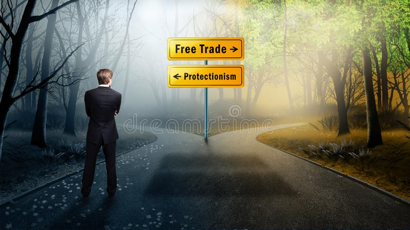 Businessman standing at crossroad having to decide between `free trade` and `protectionism` stock photo