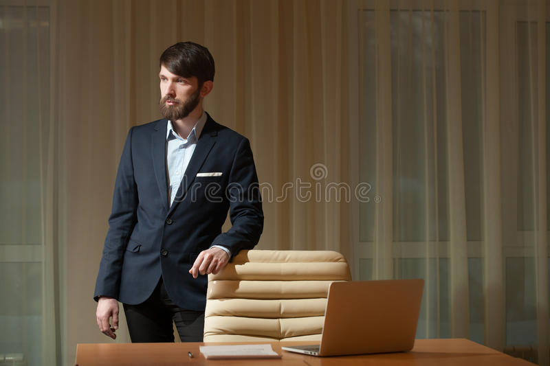 Businessman standing at desktop stock photos