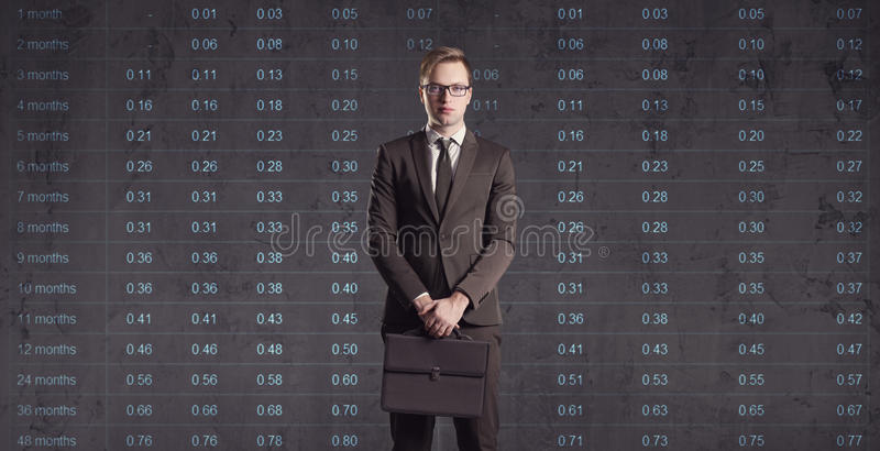 Businessman standing on a diagram background. Business, office, stock photography