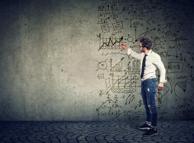 Businessman standing and drawing business ideas royalty free stock photos