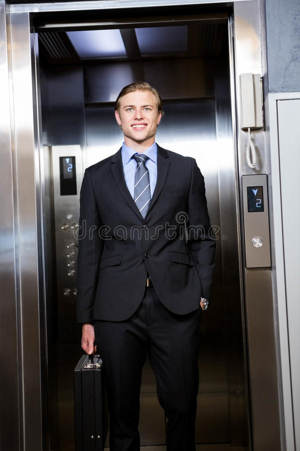 Businessman standing in an elevator royalty free stock images