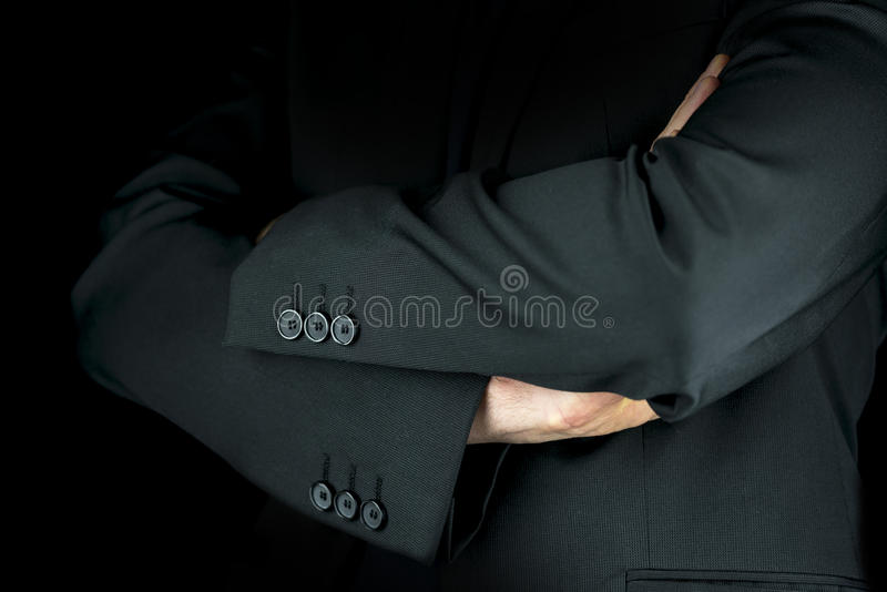 Businessman standing with folded arms stock images