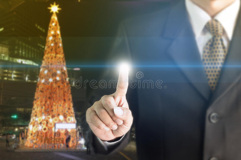 Businessman standing hand touch screen. You can add text to your ad stock images