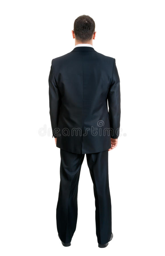 Businessman standing with his back to the studio stock photos