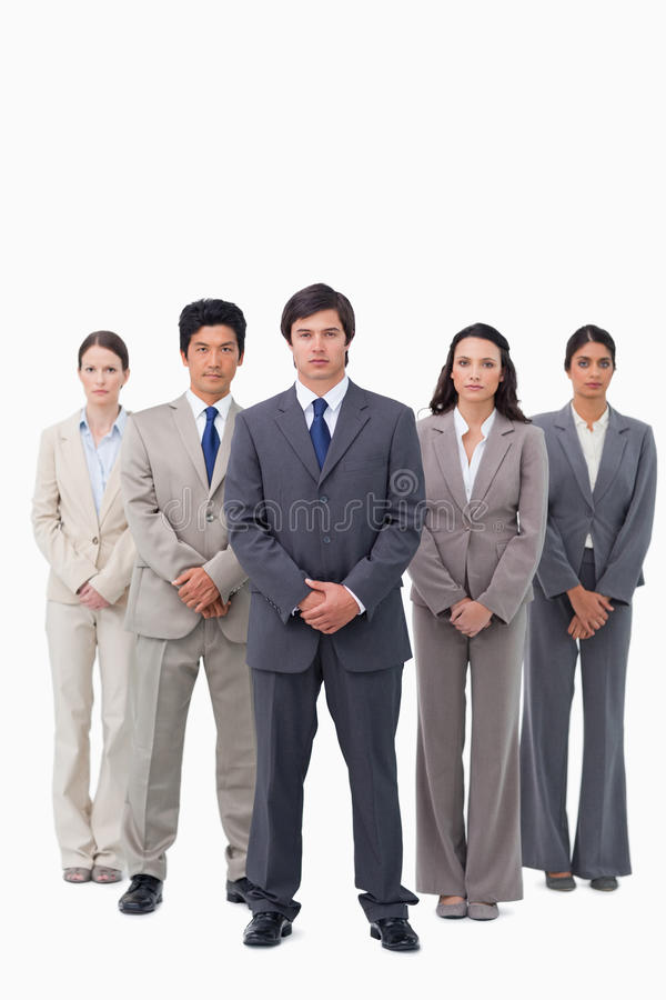 Businessman standing with his team