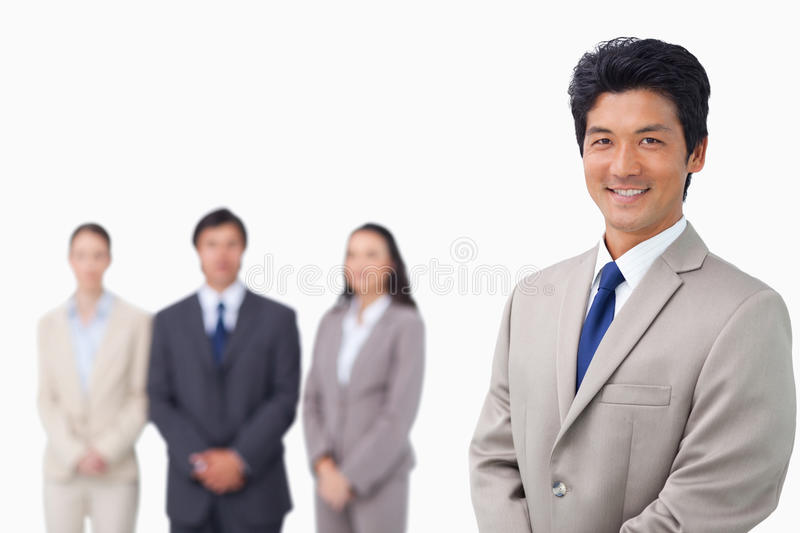 Download Businessman Standing With His Team Behind Him Stock Image - Image: 22861937