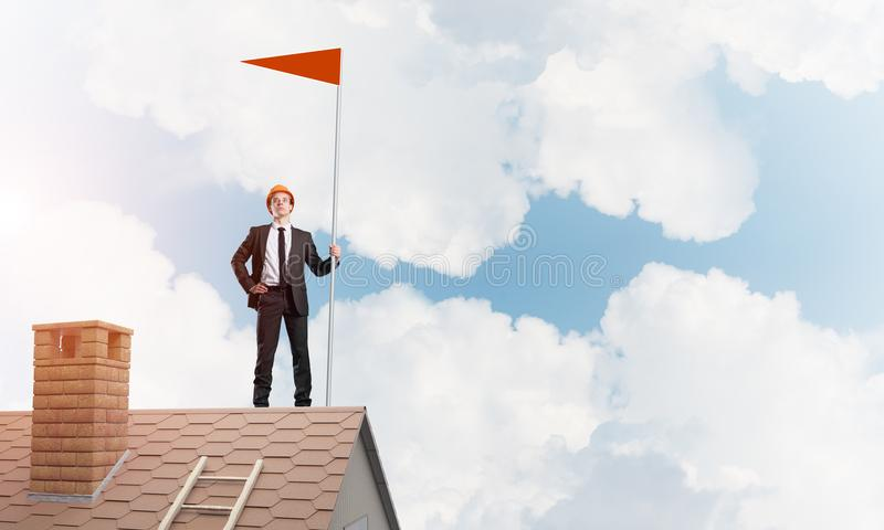Young businessman with flag presenting concept of leadership. Mixed media royalty free stock images