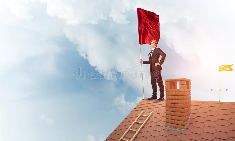 Young businessman with flag presenting concept of leadership. Mi royalty free stock photos