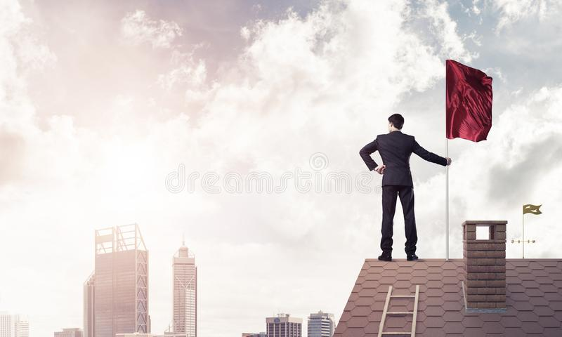 Young businessman with flag presenting concept of leadership. Mi royalty free stock images